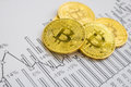 A golden bitcoin on graph background. trading concept of crypto currency Royalty Free Stock Photo