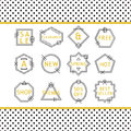 Golden and black line sale emblems set on white background with polka dots pattern framing Royalty Free Stock Photo