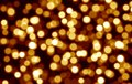 Golden blurred bokeh background,yellow circles, holiday, light effect, glow, glowing lights