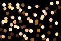 Golden bokeh on a dark background. Defocused bokeh lignts. Abstract Christmas background. Abstract circular bokeh background of Ch Royalty Free Stock Photo