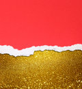 Golden bokeh lights and red torn paper Royalty Free Stock Images
