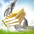Golden books and silver hands Royalty Free Stock Photography