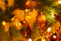Golden bow and ball on a background of green Christmas tree branches Royalty Free Stock Photo
