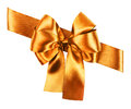 Golden bow made from silk ribbon Stock Photography