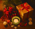 Golden box with ilex and candle burning green Royalty Free Stock Image