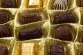 Golden box of mixed chocolates Royalty Free Stock Photo