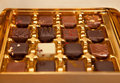 Golden Box of Square Shaped Chocolates in Different Colors and Types