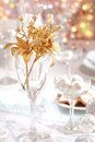 Golden branch on Christmas table Royalty Free Stock Photo