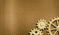 Golden or brass background with few gears Royalty Free Stock Photo