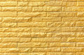 Golden brick wall background pattern texture Royalty Free Stock Photo