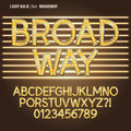 Golden broadway light bulb alphabet and digit vect set of vector Royalty Free Stock Photo