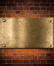 Golden or bronze plate on brick wall Stock Photo