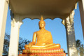 Golden budda statue with blue sky background loei thailand Stock Photography
