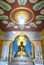 Golden budda statue sitting in church with thai style pattern Royalty Free Stock Image