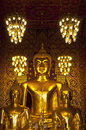 Golden buddha in church wat phra that hariphunchai lamphun thailand Royalty Free Stock Image