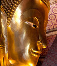 Golden buddha the face of big reclining at wat pho in bangkok thailand the image of reclining is m high and m long Stock Image