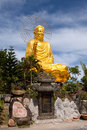 Golden buddha holding the golden lotus statue in zen buddhist temple in da lat vietnam Royalty Free Stock Photography