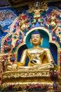 Golden buddha a large gilded deity of gautama Stock Image