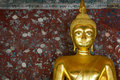 Golden buddha over grunge wall Stock Photo