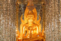 Golden buddha in sanctuary glass thasung temple uthaithani province thailand Royalty Free Stock Photo