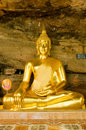 Golden Buddha statue in  cave Royalty Free Stock Photo