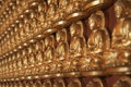 Golden buddha statue on the wall Royalty Free Stock Photos
