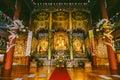 Golden Buddha Statues inside Yakcheonsa Temple. Jeju, South Korea