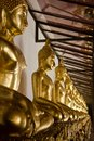 Many golden Buddha statues in Thai temple