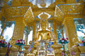 Golden buddha statues in wat thai Stock Photos