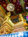 Golden buddha statute and Chief disciple statute. Royalty Free Stock Photo