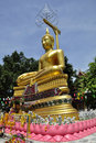 Golden Buddha under a blue sky Stock Image
