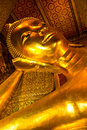 Golden Buddha in Wat Pho of Bangkok Royalty Free Stock Image