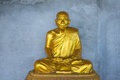 Golden Buddhist Monk Statue Royalty Free Stock Photo