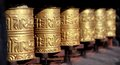 Golden buddhist prayer wheels Royalty Free Stock Photo