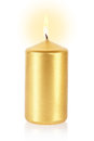 Golden candle on white Stock Image