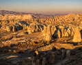 Golden cappadocia landscape turkey scenic view from çavuşin village of rock formations lit by the setting sun goreme Stock Image