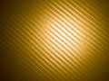 Golden carbon fiber pattern background Royalty Free Stock Image