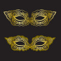 Golden carnival mask on the black background. Beautiful lace mask.