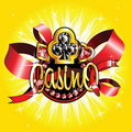 Golden casino badge on shiny background Stock Photography