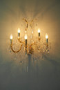 Golden chandelier on the grey wall Royalty Free Stock Photography