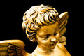 Golden cherub Royalty Free Stock Image