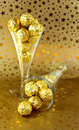 Golden chocolates Royalty Free Stock Images