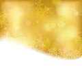 Golden christmas background with blurry lights shiny light effects and glittering snowflakes in shades of gold and a wavy contour Royalty Free Stock Photo