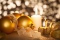 Golden Christmas background with candles, baubles and ribbons Royalty Free Stock Photo