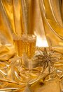 Golden christmas background glasses of champagne and accessories Stock Photography