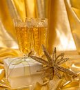 Golden christmas background glasses of champagne and accessories Stock Photos
