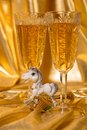 Golden christmas background glasses of champagne and accessories Royalty Free Stock Photography