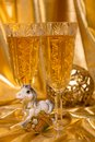 Golden christmas background glasses of champagne and accessories Royalty Free Stock Photos