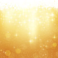 Golden Christmas background with stars and lights Royalty Free Stock Photo