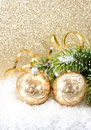 Golden christmas ball with christmas tree branch Royalty Free Stock Photo